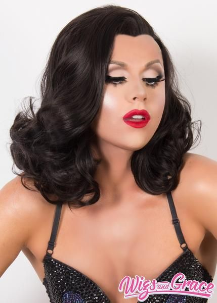 Isabella is sassy and features 16 inches of loosely curled and silky hair. This wig is made with a soft lace front cap. Isabella has a natural hairline and soft