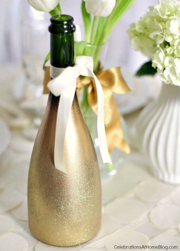 FacebookTwitterGoogle+PinterestE-mail I hope you're not tired of seeing this gold glittered champagne bottle yet, because today I'm going to tell you how I did it.  There are a few key steps to getting this look compared to many of the other inspiration pieces I've seen that actually rolled the items in gold glitter.  I don't …