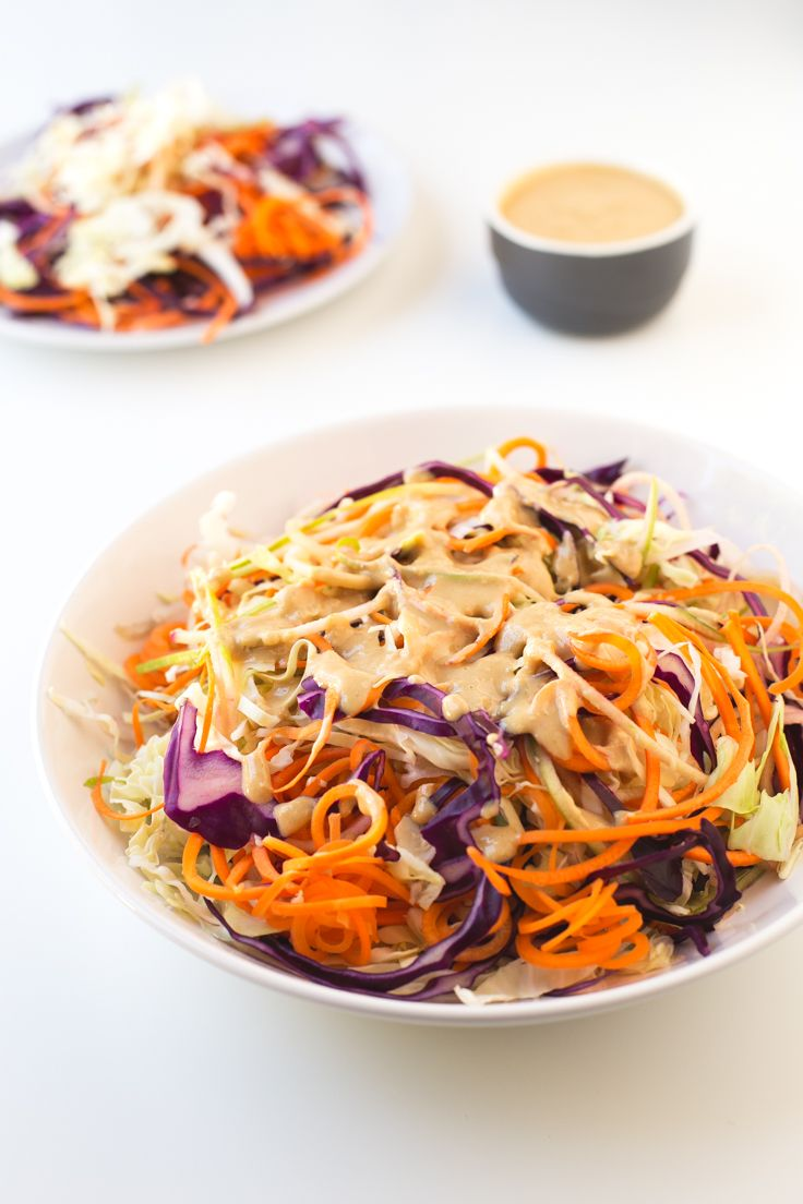 To make this vegan coleslaw I spiralized the veggies instead of chop them and I'm so happy! Spiralize veggies are so easy and the salad tasted so good!