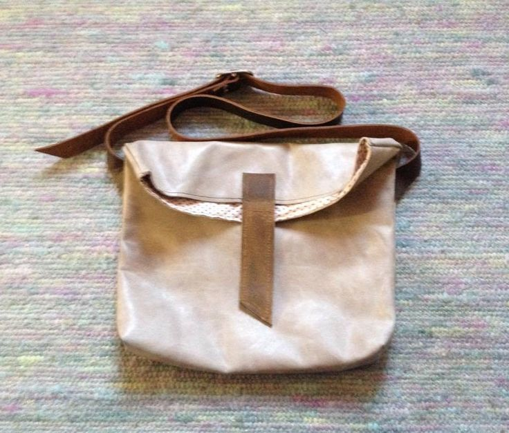 Lined leather crossbody foldedtop bag with inner pocket by IHAY