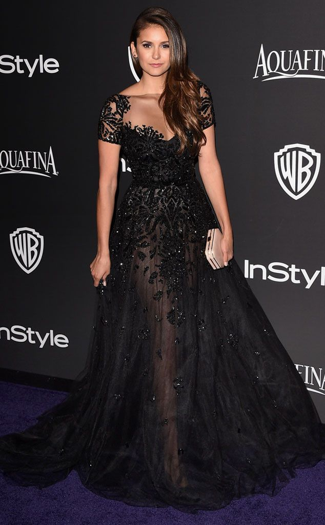 Oh my elegance! Nina Dobrev is absolutely breathtaking in a romantic sequined ball gown with a super sheer skirt.