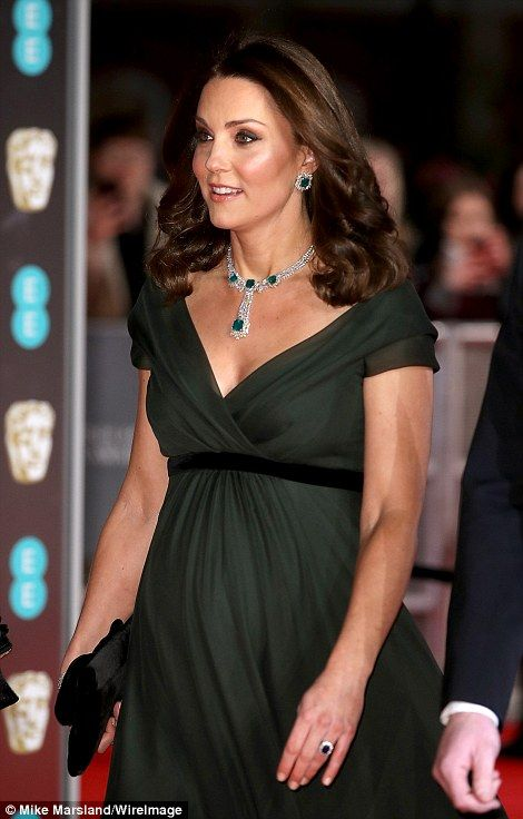 ...Glossy: Kate's hair was worn in loose waves around her shoulders, with a natural shine to her hair