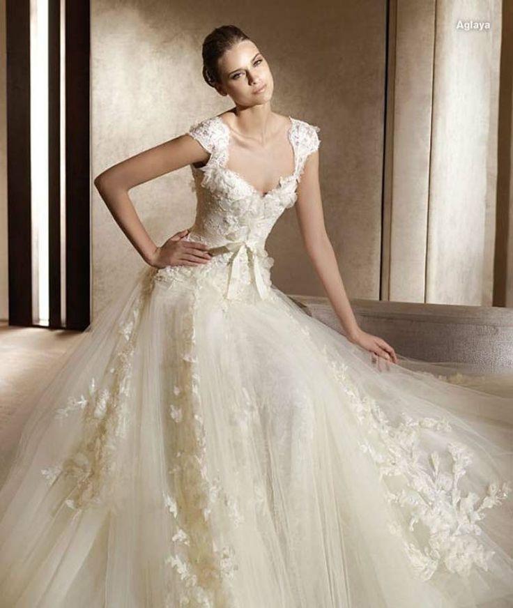 Google Image Result for http://bridesmine.com/wp-content/uploads/2011/09/v-neck-vintage-wedding-dresses-2012-c.jpg