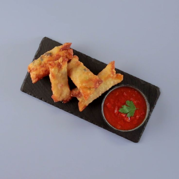 Pizza in spring roll form. A great appetizer for your party or a meal!