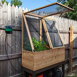 Went a little overboard making my herb garden. Features include an elevated bed, screened enclosure and a solar powered watering system.