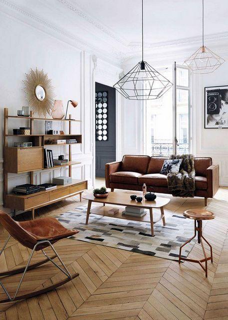 Appartement réaménagé - le parquet ancien s'intègre parfaitement à cette décoration contemporaine dont la pièce phare est ici le luminaire type origami. Merci pour le re-pin :) #design #contemporain #appartement