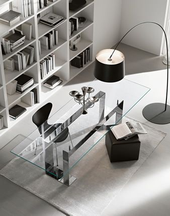 Contemporary home office design with The glass table top is placed on 4 supports that lift the top from the lacquered or chrome plated metal basement