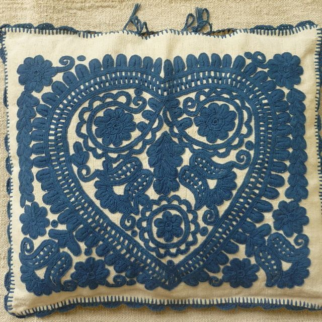 Hand embroidered on home loomed vintage hemp Vintage cushion cover Blue embroidery on a pale home loomed vintage linen with crochet trim Heart design