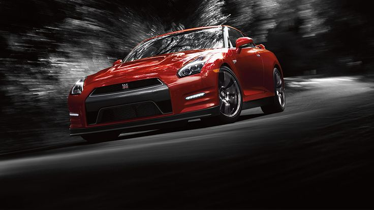 2016 Nissan GTR sports car shown in regal red driving with black and white background