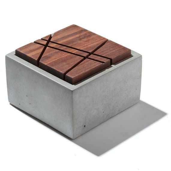 Hold your prized possessions in this beautifully crafted concrete box with geometric sliced wood lid. A great place to store jewelry or small important items. Also great for bathrooms and wet areas. Comes with hand stamped bottom and cork pad feet. Lid comes hand sanded and oiled with