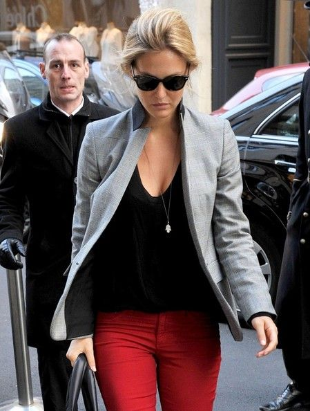 Business casual work outfit: grey blazer, black top, red skinny pants.