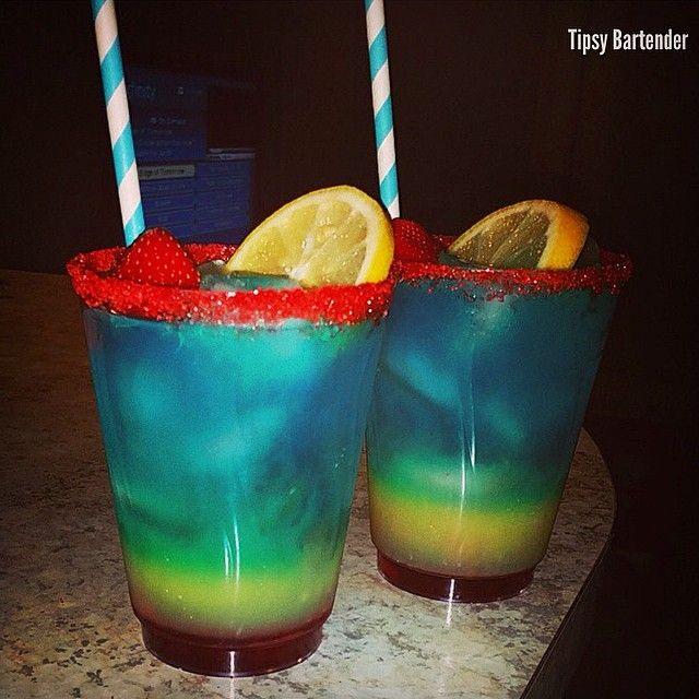 The Typhon (1/2 oz Grenadine 2 oz Orange Juice 1 oz Blue Curacao 1/2 oz Midori 3/4 oz Silver Tequila)