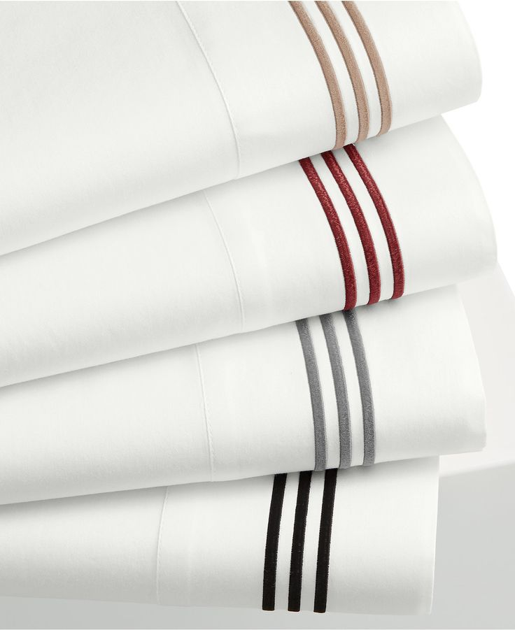 Refine your classic bedding style with this Merrow Line queen sheet set, crafted from smooth cotton fabric finished with embroidered stripes at the hem. | Cotton | Machine washable | Imported | Set in