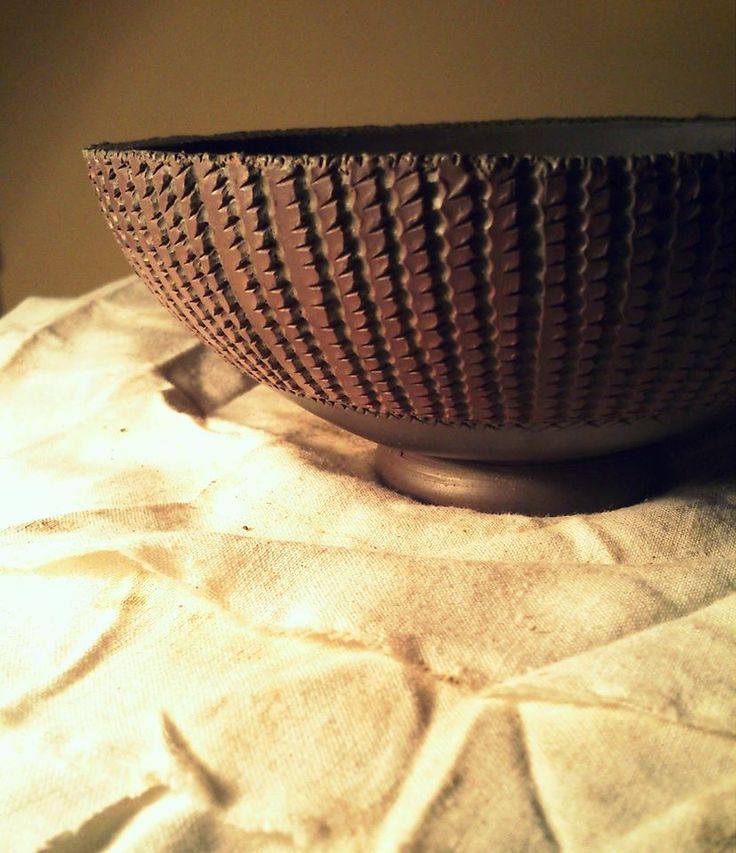 Small bowl with textured surface made in pinching technique