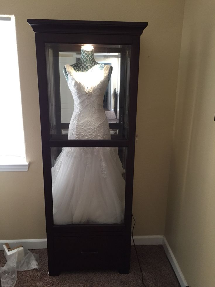 """""""Shadow box"""" for wedding dress. Get a china cabinet and dress form, and add your wedding dress! It is a shame to keep it tucked away, why not display?!?"""