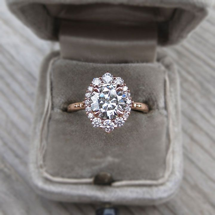14k recycled rose gold band with center moissanite surrounded by .33 ct. diamonds in an oval halo by Kristen Coffin