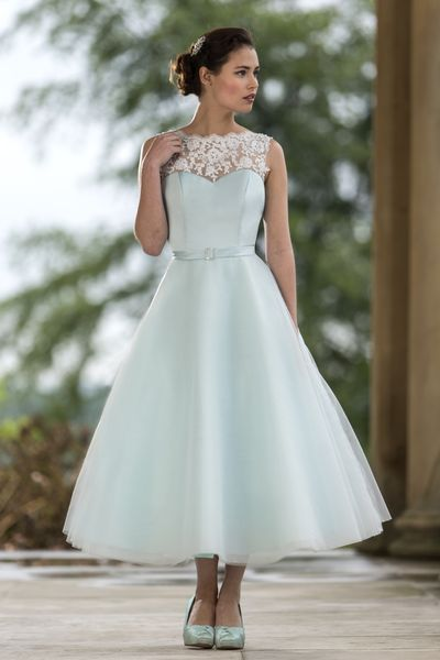 Wedding Dresses & Bridesmaids | True Bride | M566 | Tea length bridesmaid dress with Lace boat neck, Satin bodice and Tulle circle skirt. Satin belt with sparkly buckle. Zip up back with button trim. Pictured here in Shallow Blue.