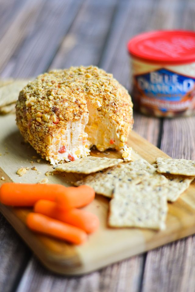 A creamy pimento cheese ball rolled in smoky roasted almonds! #GameChangingSnacks #sponsored