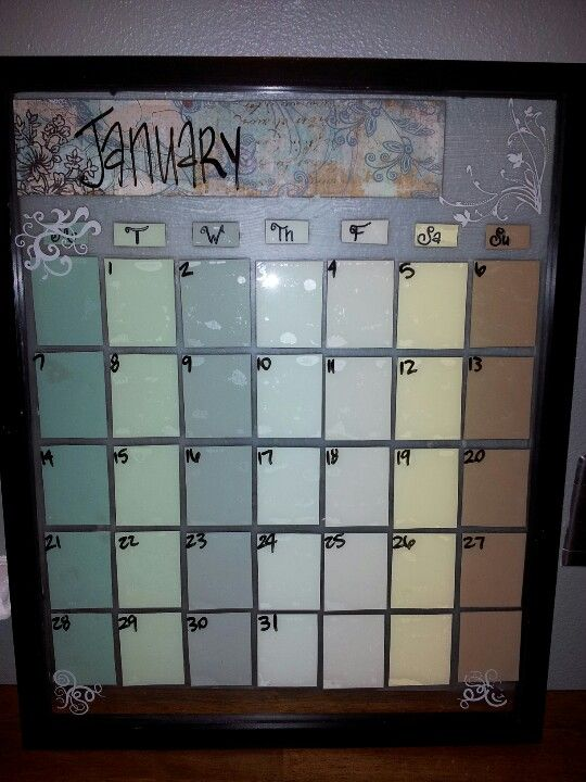 Paint chip calendar in 11x14 frame. Used scrap book paper to decorate. Also used the etching designs for more decorations.