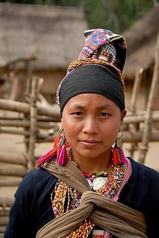 Laos | Portrait of young woman of the Akha Loma ethnic group in traditional costume. Muang Mai district, Phongsali province | ©Imagebrokerrm