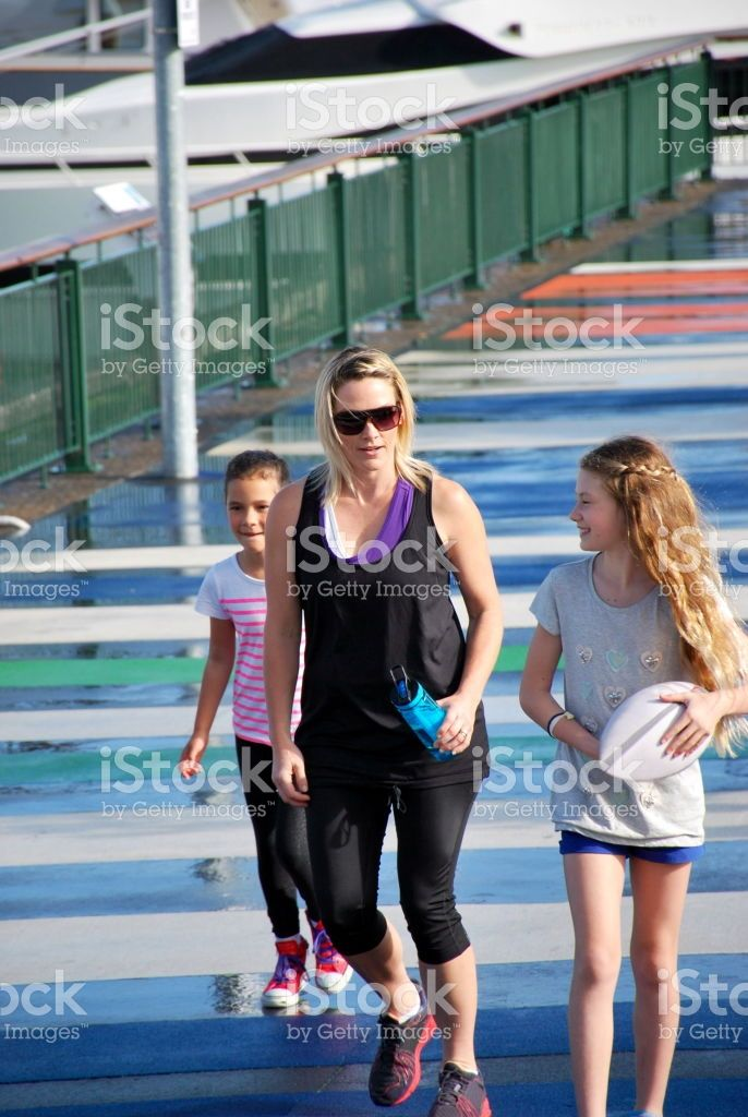 A Mother and Daughter with Friend walk in a cityscape background. royalty-free stock photo
