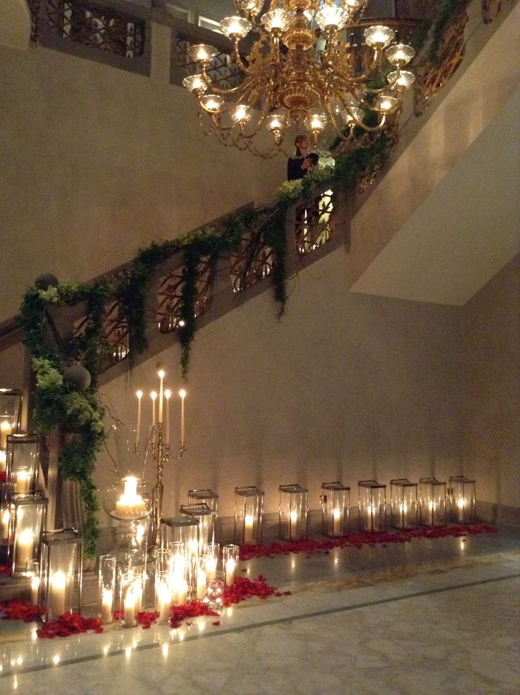Greenery, petals, lanterns and candles to decorate the stairs area