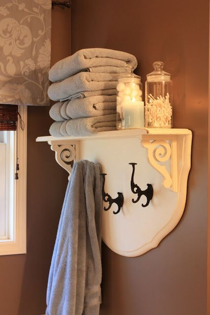 Small shelf placed over headboard from old cot = diy towel rack