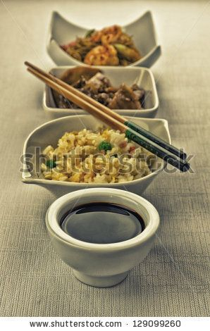 Chinese food composition with cantonese rice, noodles with prawns and beef with mushrooms by MilaCroft, via ShutterStock