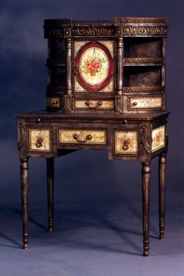 Ink:  Victorian Desk.  Inspired by an aristocratic English antique auctioned at Christie's, this lovely ladies' desk offers a pull-out surface for writing, lined drawers, antiquated crackle finish, and myriad details.
