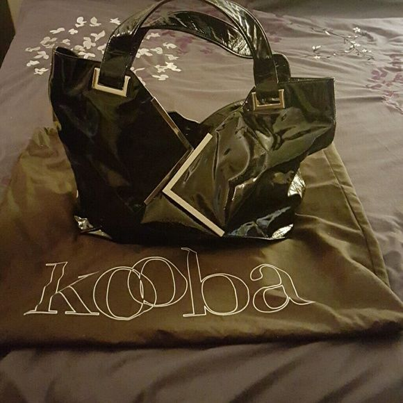 """Make an offer! Kooba tote Large black patent leather tote bag. Good condition.  One small scratch on the bottom.  Spacious interior with phone pockets and zipper pocket. Snap and zipper closure.  I never used the zippers because of the diagonal shape of opening of the bag. Great travel and worm tote. Can fit an ipad mini or notebook / agenda. 15"""" x 9 1/2"""" x 5"""" interior space. I'm 5' tall for size reference and this does not feel too big for me. No trades. Kooba Bags Totes"""