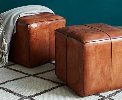 Buttery, deeply tanned leathers are rooted in the history of Western desert culture. Pay homage to this look—and add a modern twist— by using leather as an accent throughout your space. A pair of cognac-hued poufs are a nod to tradition that also serve as extra seating and impromptu tables.
