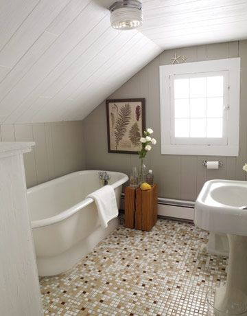 I'm liking the gray bathrooms. And that wood pedestal table thing.