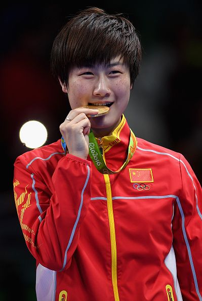 #RIO2016 Ning Ding of China celebrates with her gold medal after victory over Li Xiaoxia of China during the Womens Table Tennis Singles Final match at Rio...