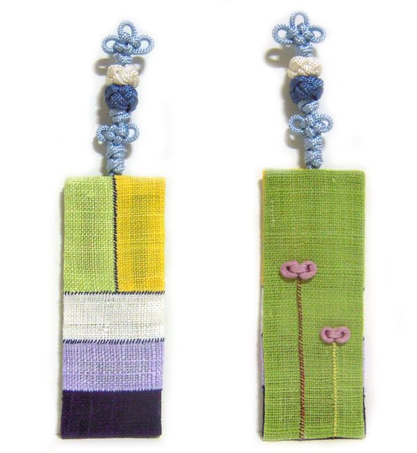 This is a Bookmark. I made it from Ramie fabric. It's Korea traditional Sewing Patchwork and Korea traditonal Knot. http://rimkimstudio.blogspot.com/2014/01/bookmark-handmade-korea-traditional.html