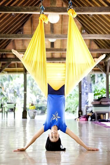 ok, I'm envisioning an aerial yoga Bali vacation with strong cross beams, and a dozen inverted yoginis with huge smiles and happy backs.. - anyone care to join me