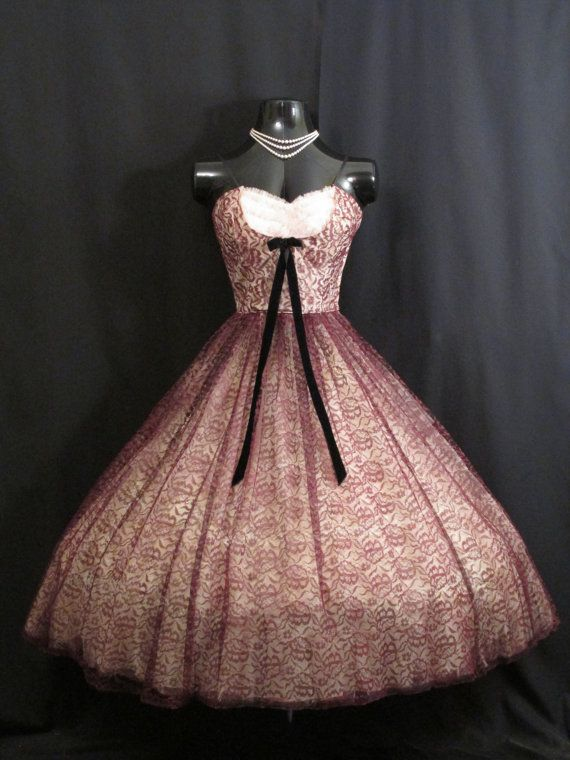 Description  A drop dead gorgeous strapless 1950's prom dress in a striking and very unusual color combination. The effect of the two tone lace is