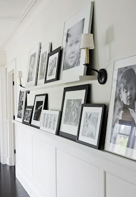 gallery wall: like the idea of a longer shelf underneath. I like this can easily change your photos.