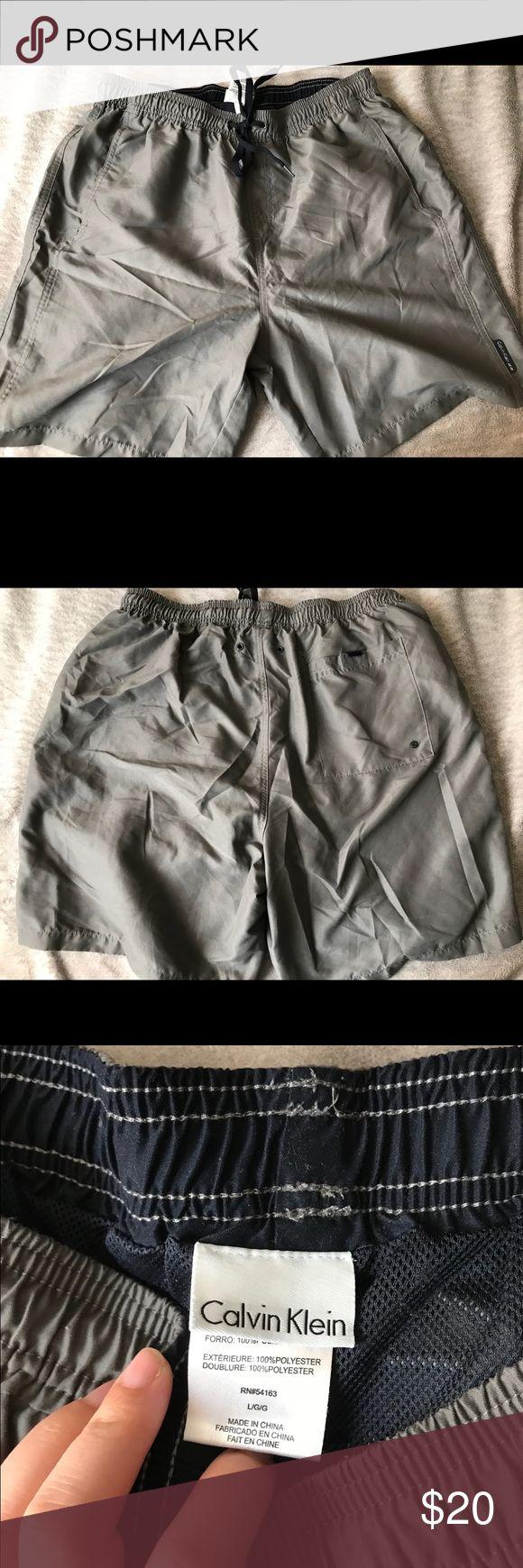 Calvin Klein Men Swim Shorts Gray swim trunk shorts in great condition Has been worn once Calvin Klein Swim Swim Trunks