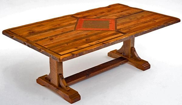 This refined rustic trestle table done in old country side barn wood adds that western feel to your dining room. This two single legs with two corbels gives the table solid strength without adding bulk. The beautiful old aged top comes from hand honed barnwood from the heartland of America.  Optional Inlaid Top: Our craftsman then