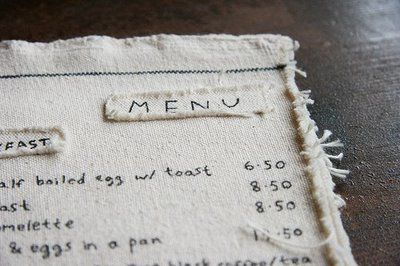 Felt on fabric menu - haven't seen that before! Perhaps you just wash them when you want to change your menu? Very interesting...
