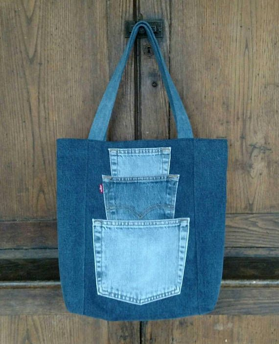 Pick a Pocket Tote Bag... Sturdy yet stylish, this large one-of-a-kind tote bag will soon become your trusted companion for every adventure. Made of gently pre-loved dark blue denim, both the front and the back feature a stack of storage options in the form of strategically placed jean