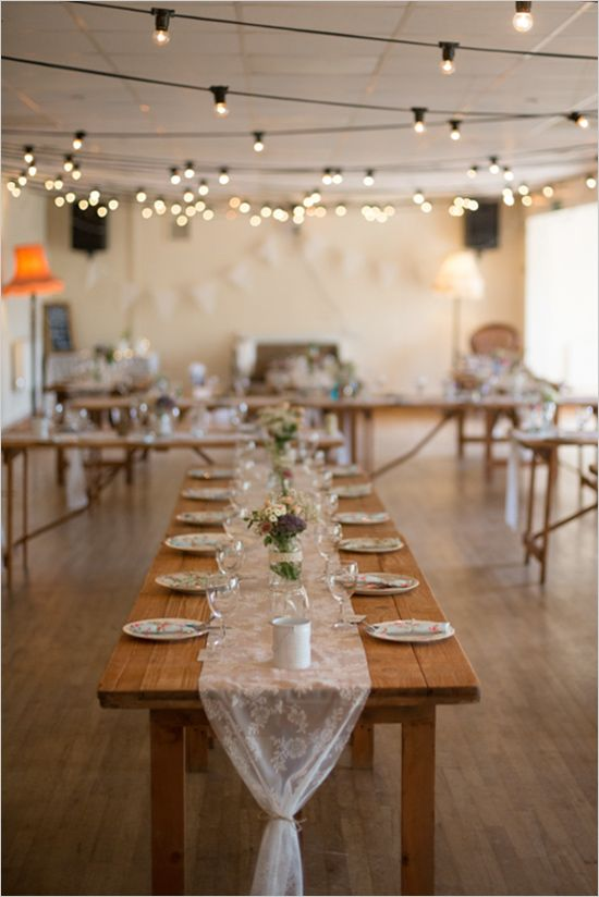 Simple, indoor stranded lights for reception. Captured By: Christie Graham Photography ---> http://www.weddingchicks.com/2014/05/15/create-a-darling-wedding-for-under-5k/