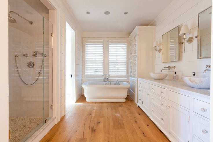 #Bathroom #Transitional #Coastal #BeachStyle | #Flooring #WhiteOak | #Shiplap #Poplar #1x8 #WallColor #WhiteDove #SatinImpervo by #BenjaminMoore | #Vanity by #BotticelliAndPohl | #Tub #Empire #Lighting #Sconce #Mirror all by #Waterworks | #Shower #SubwayTile by #MexicanHandcrafter #Pebbles by #Nantucket