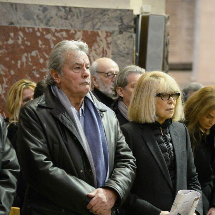 Alain Delon et Mireille Darc - Hommage à Georges Lautner en l'église Saint-Roch à Paris le 5 décembre 2013