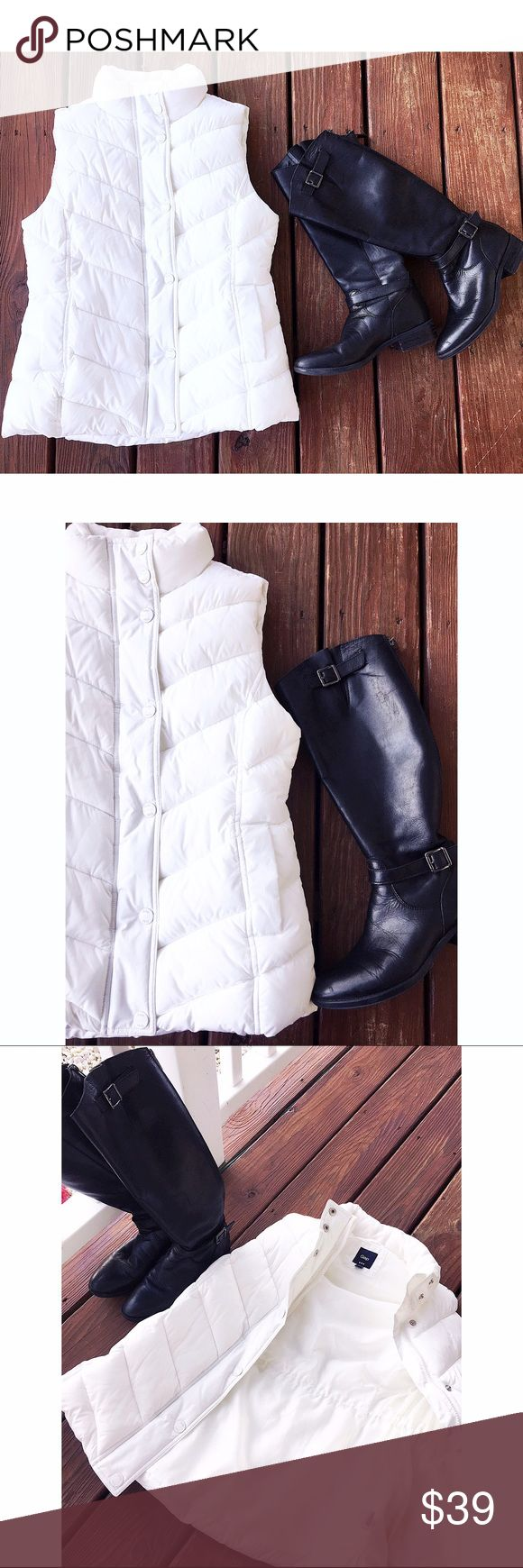 💲Cyber Monday Sale💲NWT! White Gap puffer vest White Gap puffer vest! 2 side pockets✔️ 7 front white buttons✔️zipper✔️elastic stringe inside the coat  to cinch the waist✔️ this vest is so white and pretty like a winter wonderland ❄️❄️❄️❄️❄️❄️❄️❄️❄️❄️❄️❄️❄️❄️❄️make an offer ❤️️no trades thank you GAP Jackets & Coats Vests