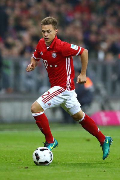Joshua Kimmich of Muenchen runs with the ball during the Bundesliga match between Bayern Muenchen and Borussia Moenchengladbach at Allianz Arena on October 22, 2016 in Munich, Germany.