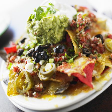 The Ultimate Nachos Recipe: Chilli beef with guacamole, sour cream and salsa
