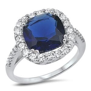 A Perfect 7CT Cushion Cut Blue Sapphire Halo Ring
