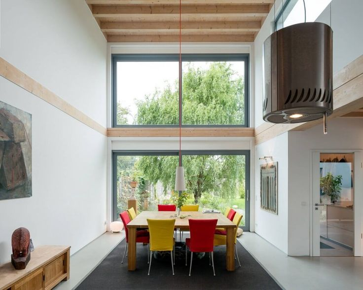 Contemporary Timber House by Stommel Haus UK.  wish the open glass and timber ceiing was over the kitchen instead of the dining area.