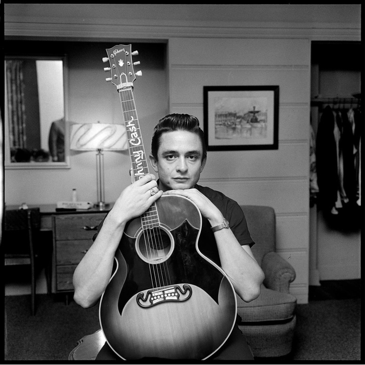 A great picture of a young Johnny Cash. Note the custom Gibson guitar and the pick guards.